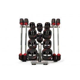 A Les Mills SMARTBAR™ rack with the SMARTBAR™ and weights